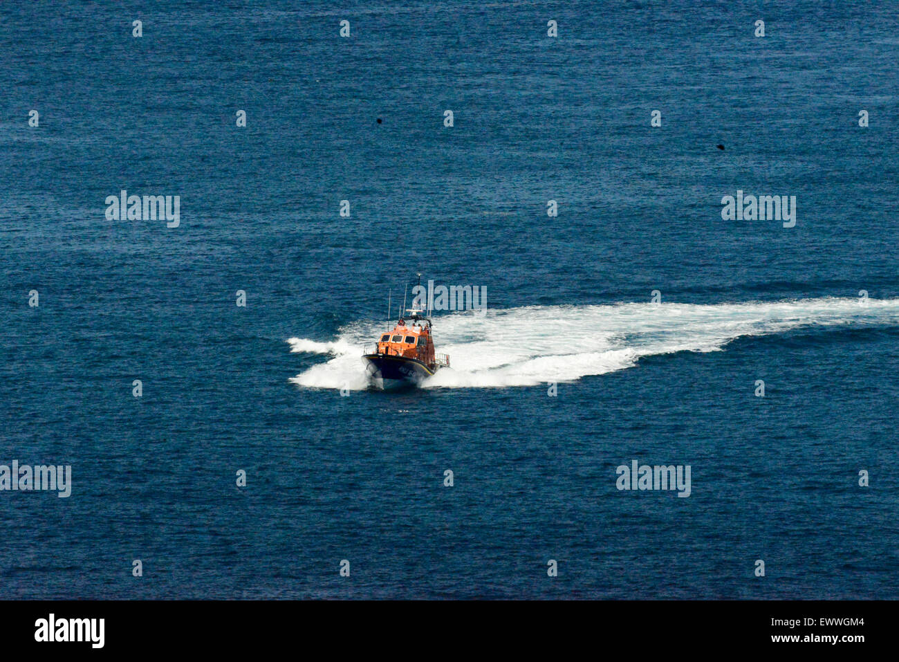 Padstow Lifeboat carrying out search and rescue operation around Trevose head and the Camel Estuary. Cornwall UK - Stock Image