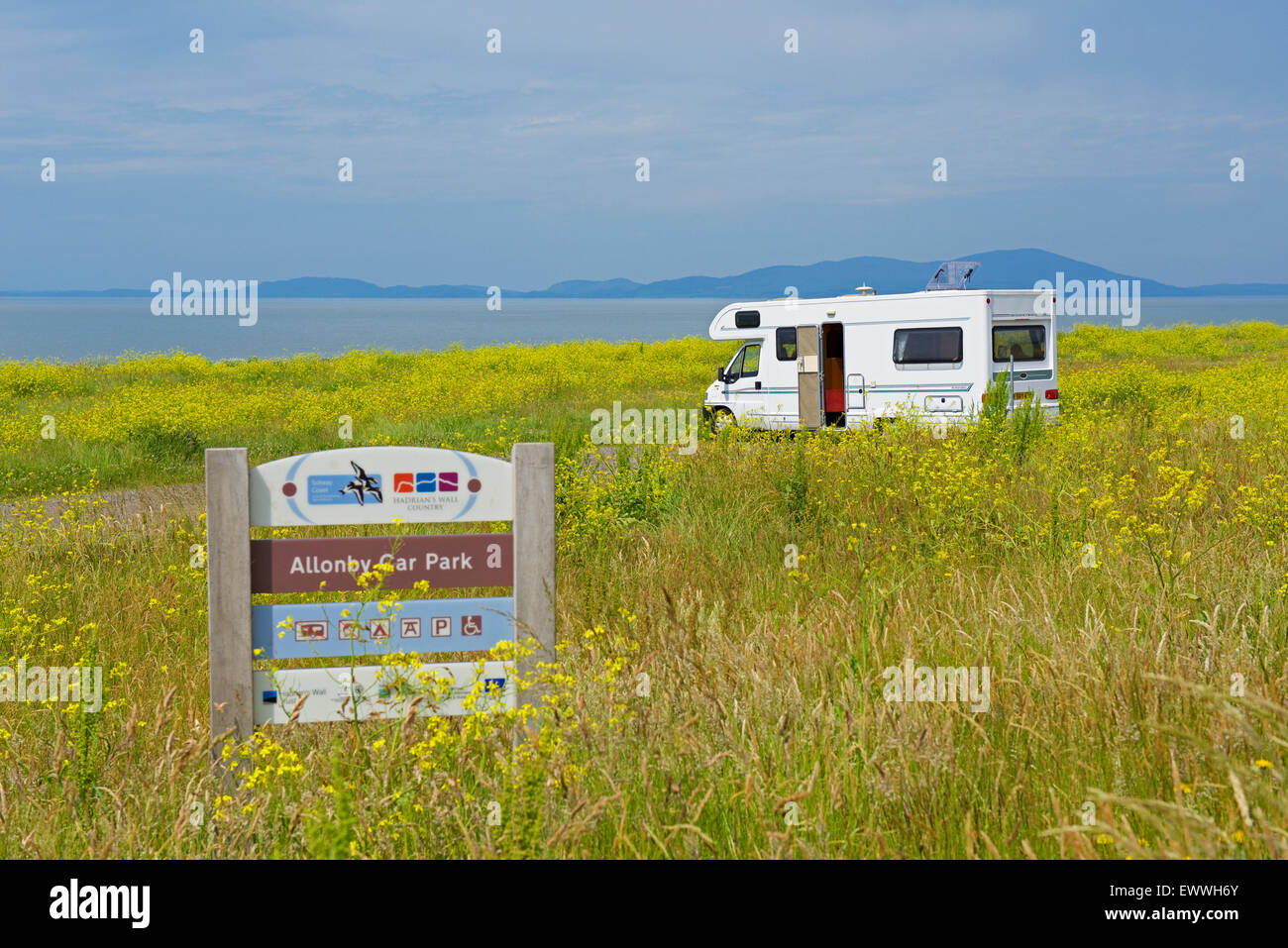 Motorhome parked in flowery dunes, with view of Solway Firth, at Allonby, West Cumbria, England UK - Stock Image