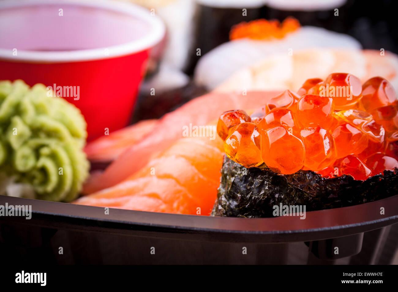 Salmon caviar ikura sushi with selective focus, close up - Stock Image