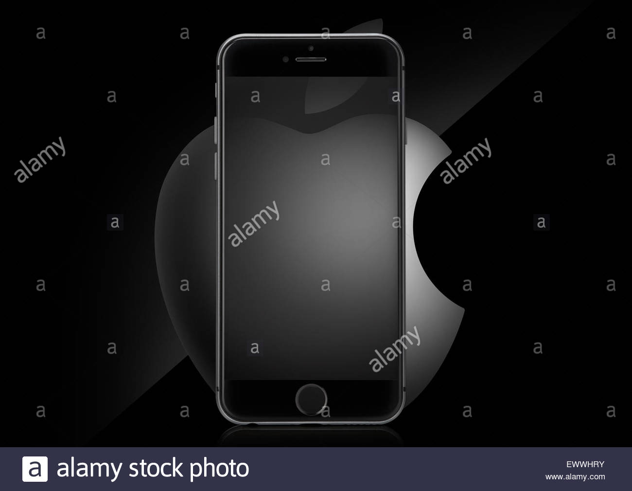 Apple Logo with Apple Iphone 6 on top and a black background - Stock Image