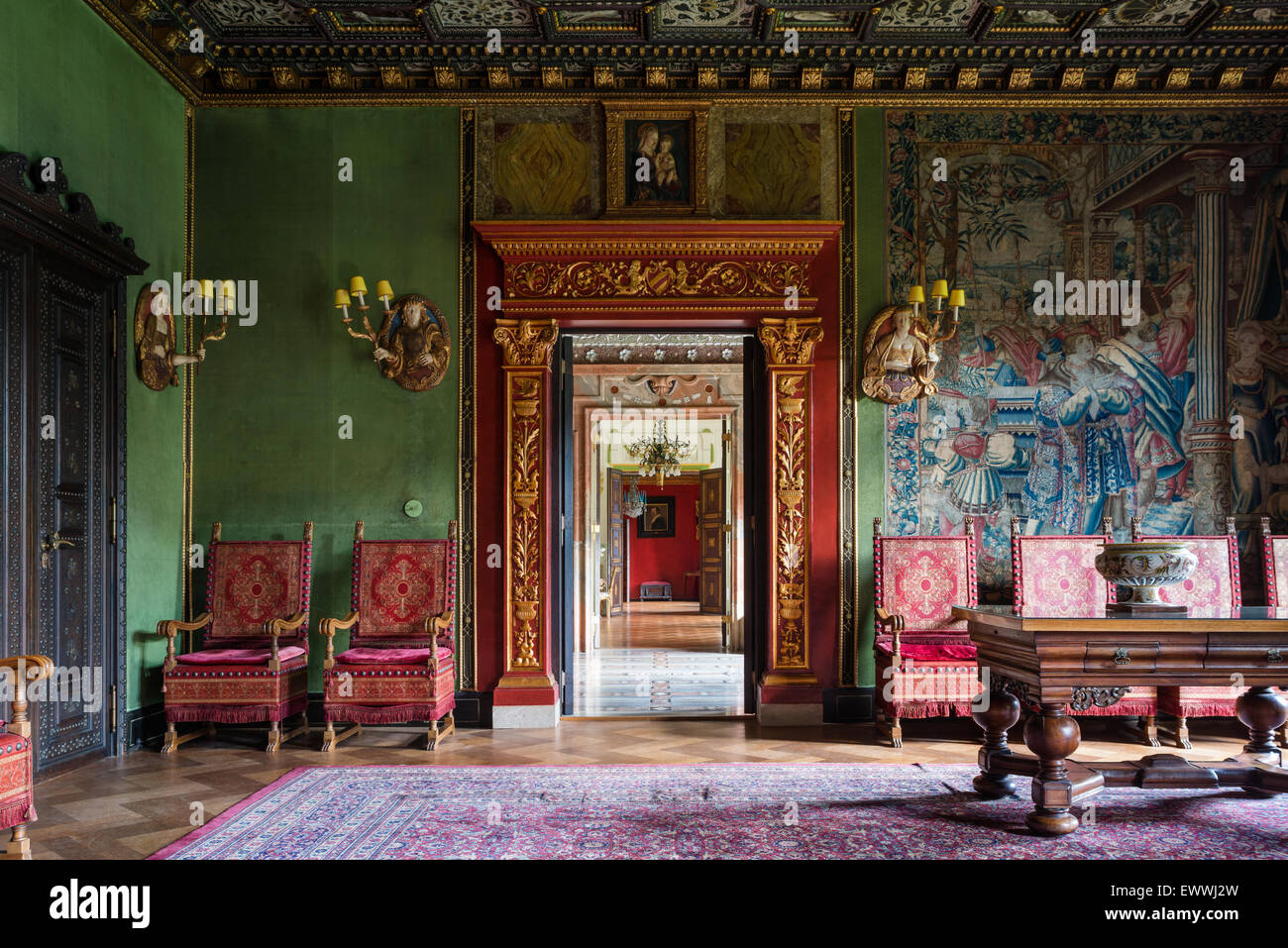 View through a series of galleries / rooms in a stately home with parquet flooring, antique wall tapestries and - Stock Image