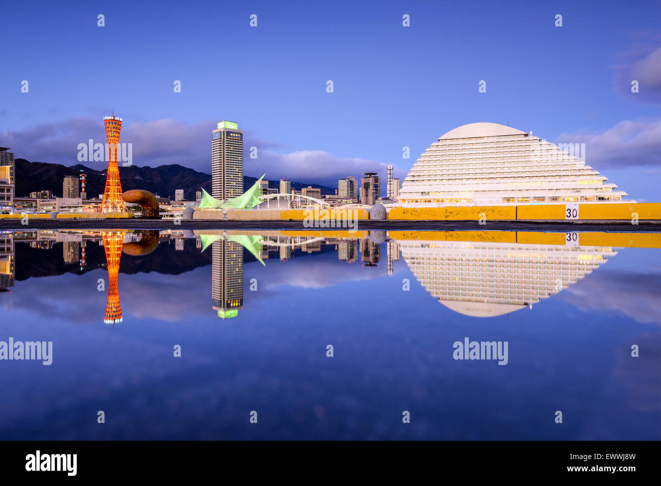 Kobe, Japan skyline with puddle reflections. - Stock Image