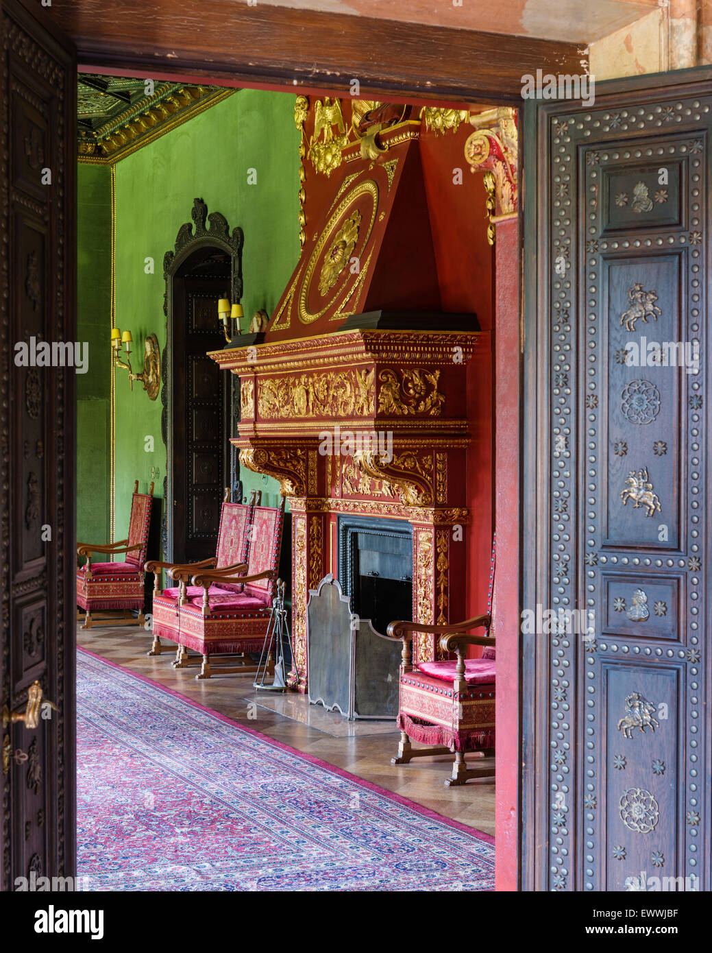 Ornate gilt stucco fireplace in stately home - Stock Image