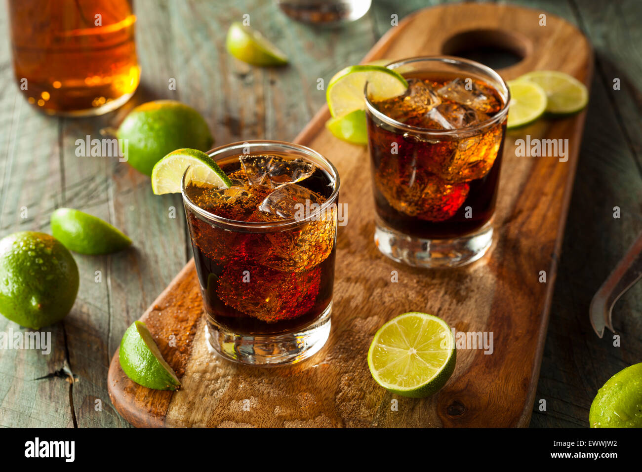 Rum and Cola Cuba Libre with Lime and Ice - Stock Image