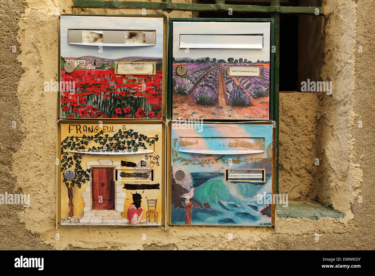 Colourful postboxes at a house in Sommieres, France. Sommieres has Roman origins and its Old Town dates from the - Stock Image