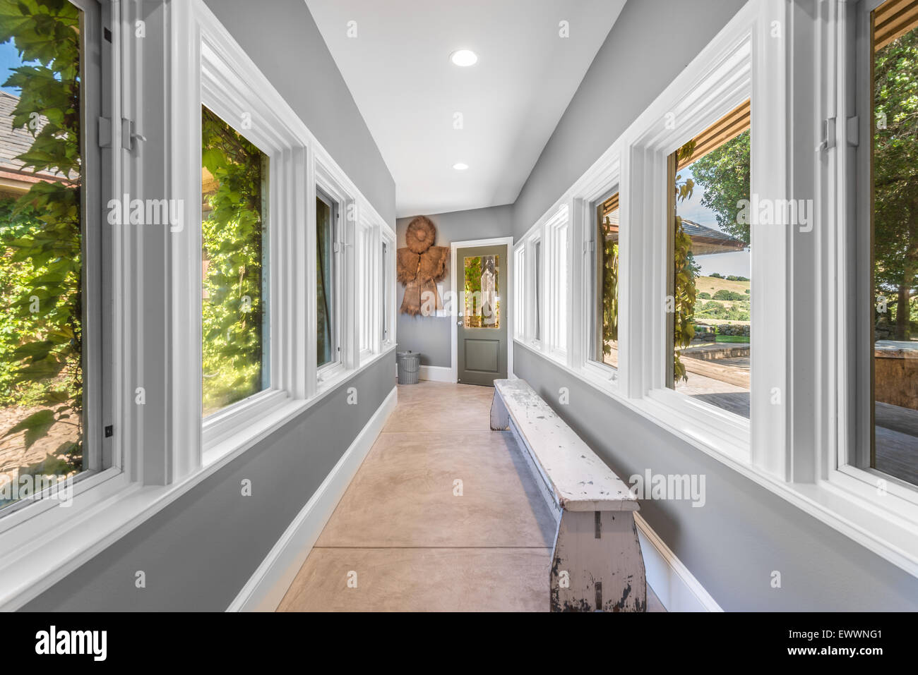 Long distressed wooden slab bench inside new modern home hallway - Stock Image