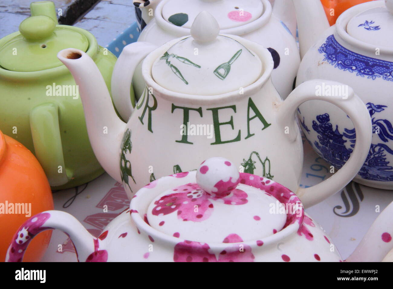 Traditional crock teapots at a vintage style tea stall at Chatsworth Country Fair, Peak District Derbyshire England - Stock Image