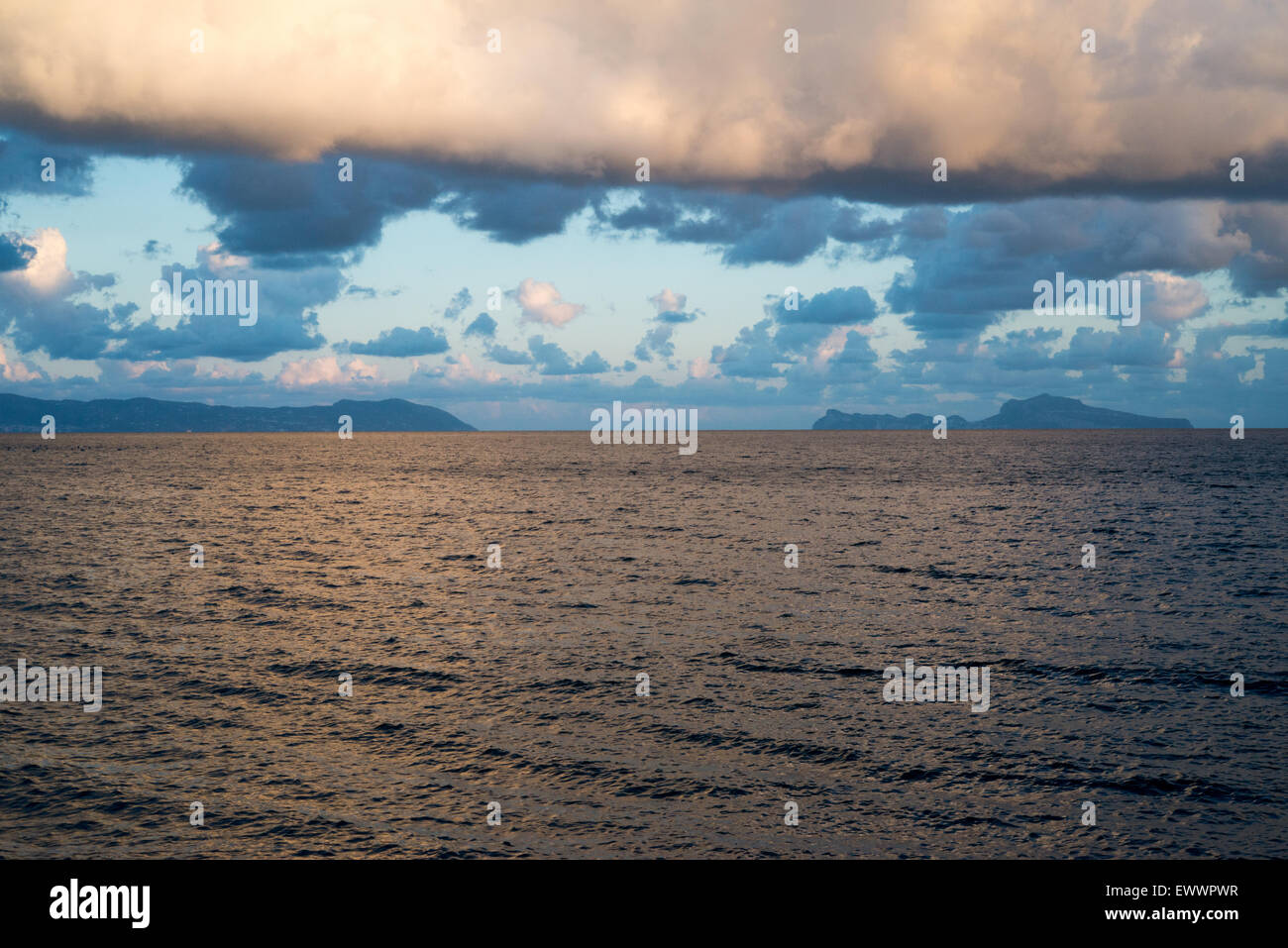 view of the gulf of naples on a cloudy evening - Stock Image