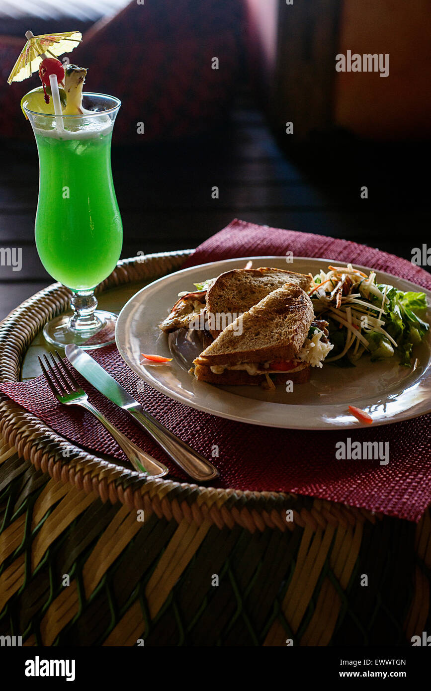 The grilled chicken sandwich and green tsunami cocktail at the Mata Chica resort in Belize - Stock Image