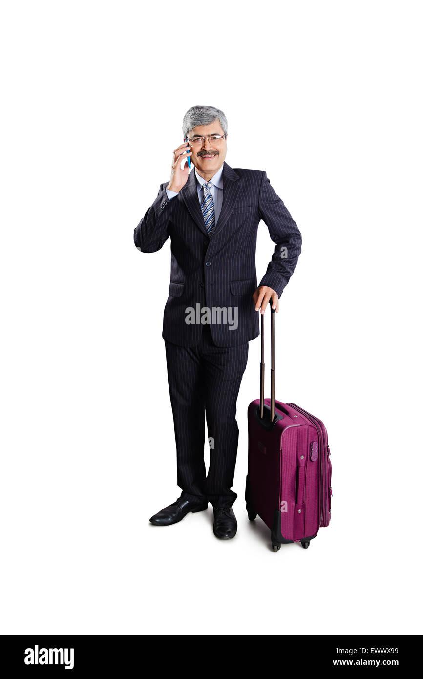 1 indian Business Man Passenger talking Cell Phone - Stock Image