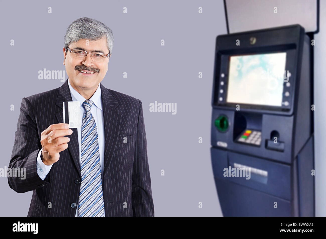 Cash advance machine atm stock photos cash advance machine atm 1 indian business man credit card showing stock image reheart Images