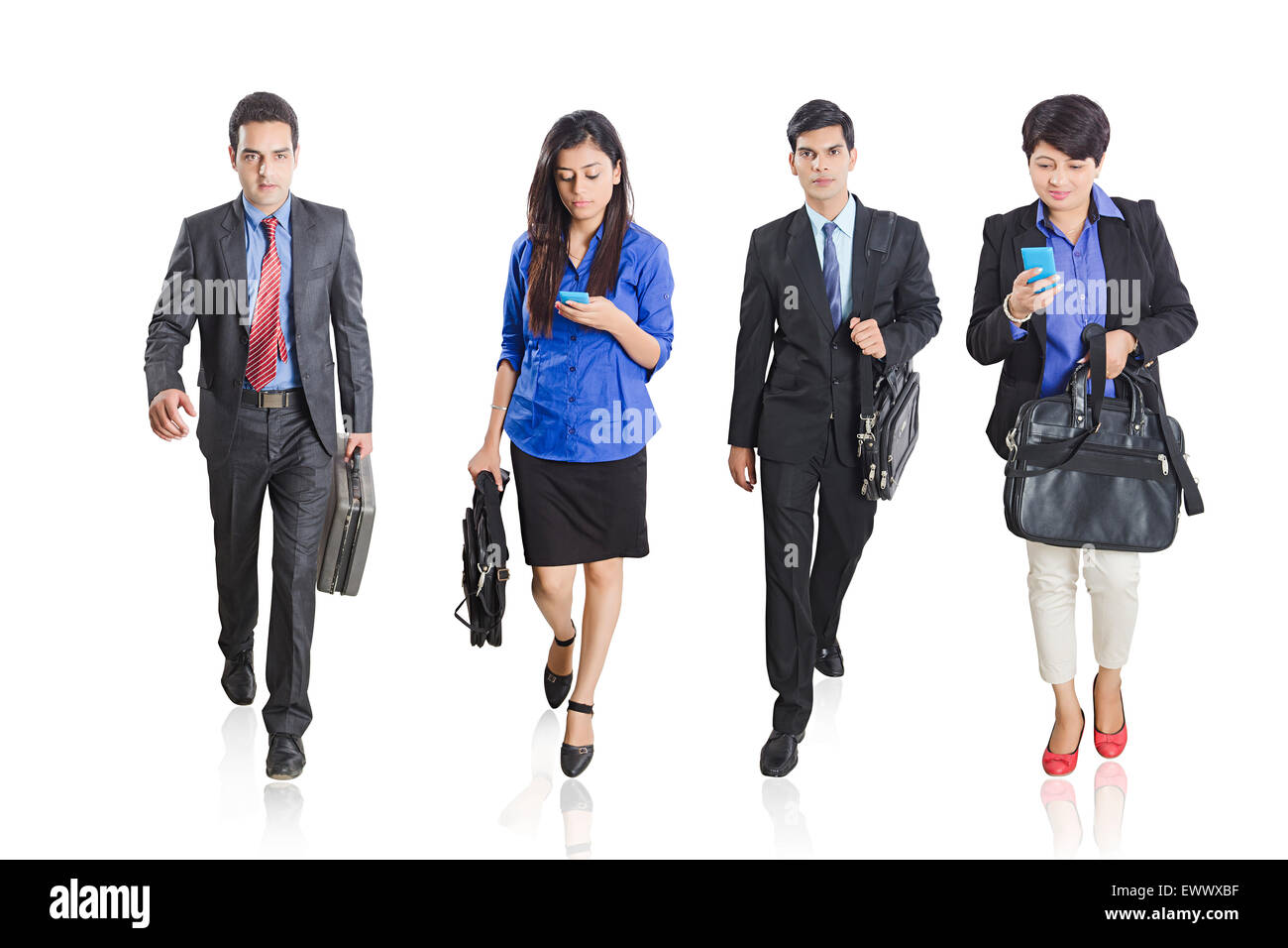 4 indian Business Partner  Walking and Dialling  Cell Phone - Stock Image