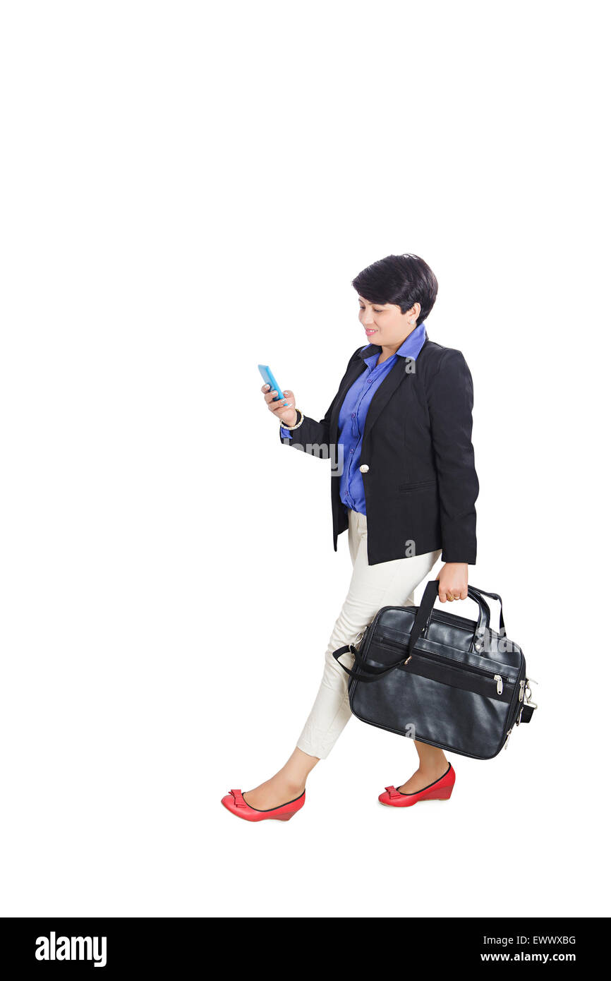 1 indian Business woman Walking  Dialling  Cell Phone - Stock Image