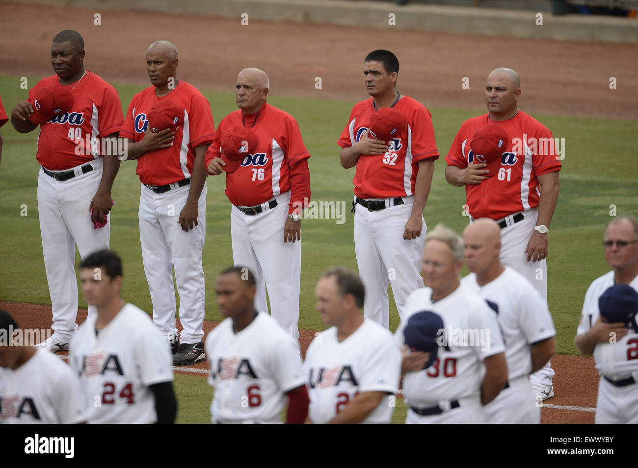 Cary, North Carolina, USA. 1st July, 2015. Cuba coaching staff listen to the national anthem during game 1 of the - Stock Image