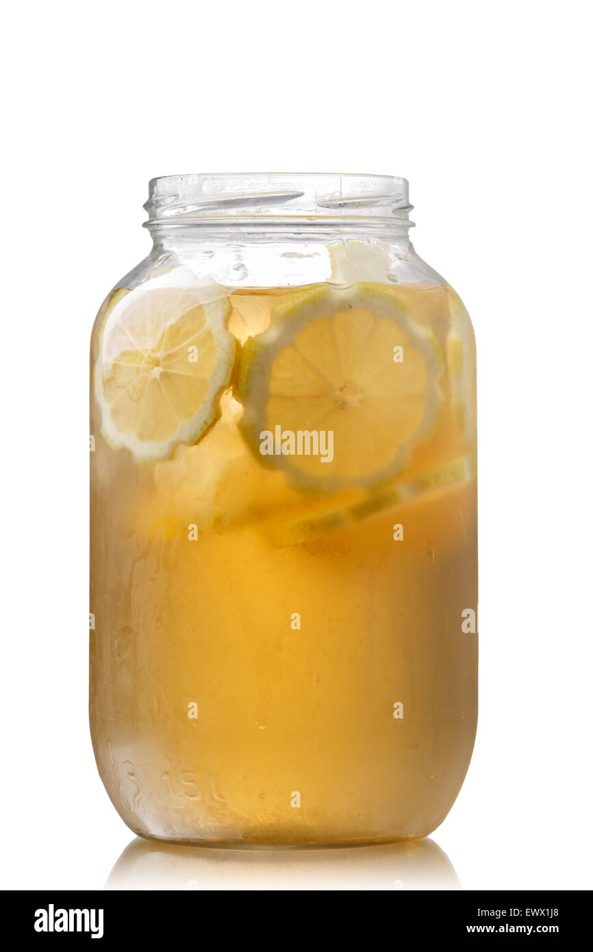 Pitcher of sweet iced green tea with lemon - Stock Image