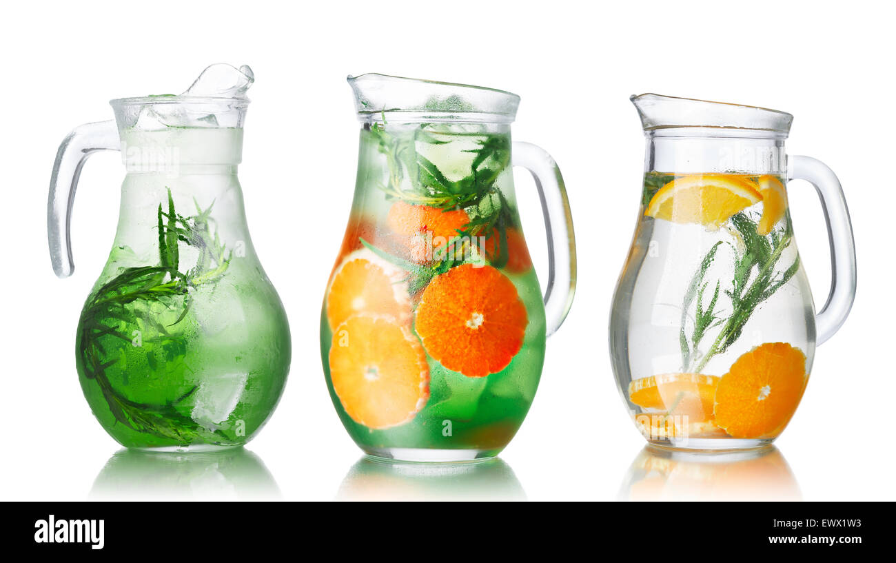 Collection of glass pitchers with tarragon infused detox water - Stock Image
