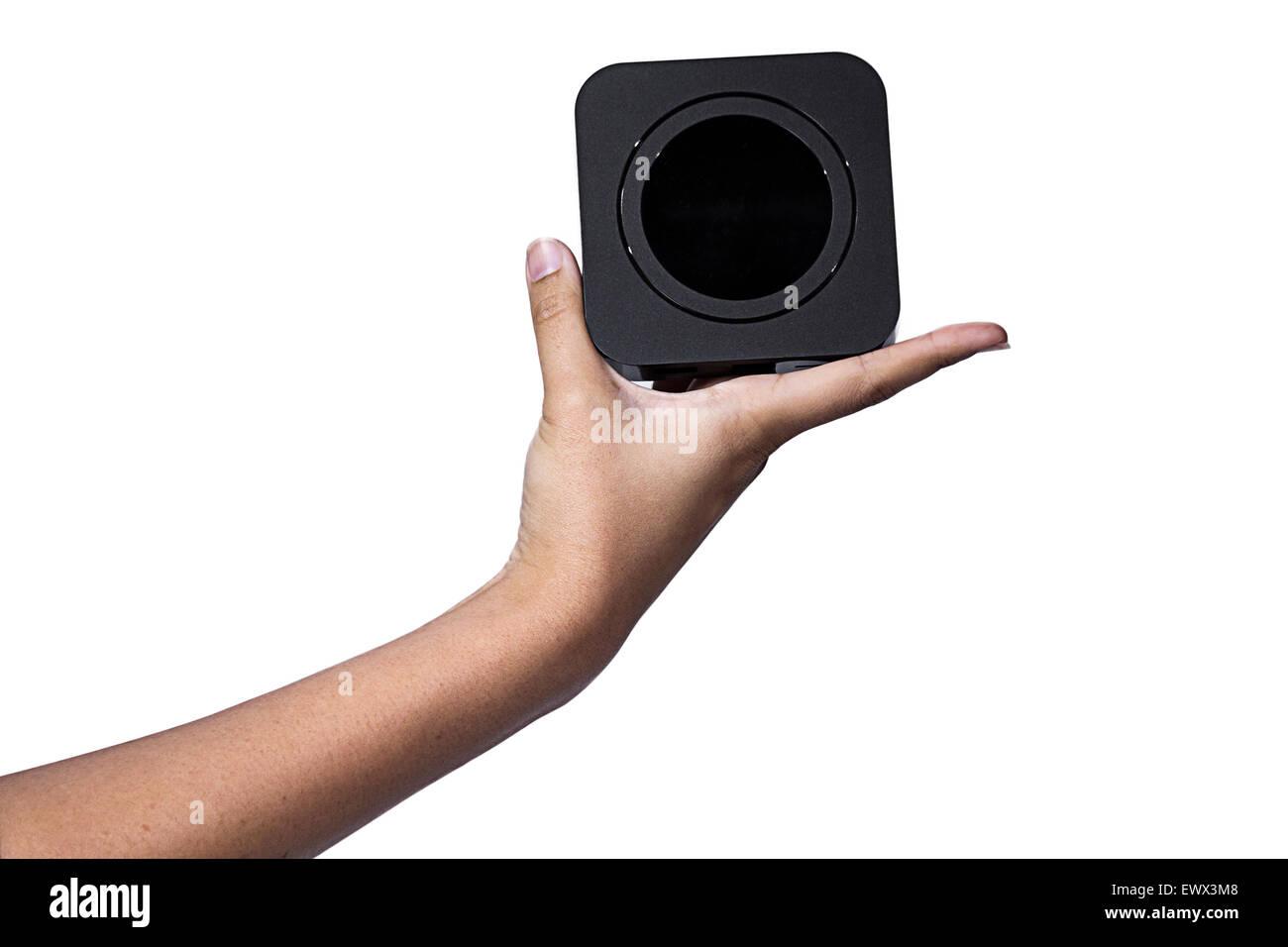 Hand holding square black box and black circle inside box - Stock Image