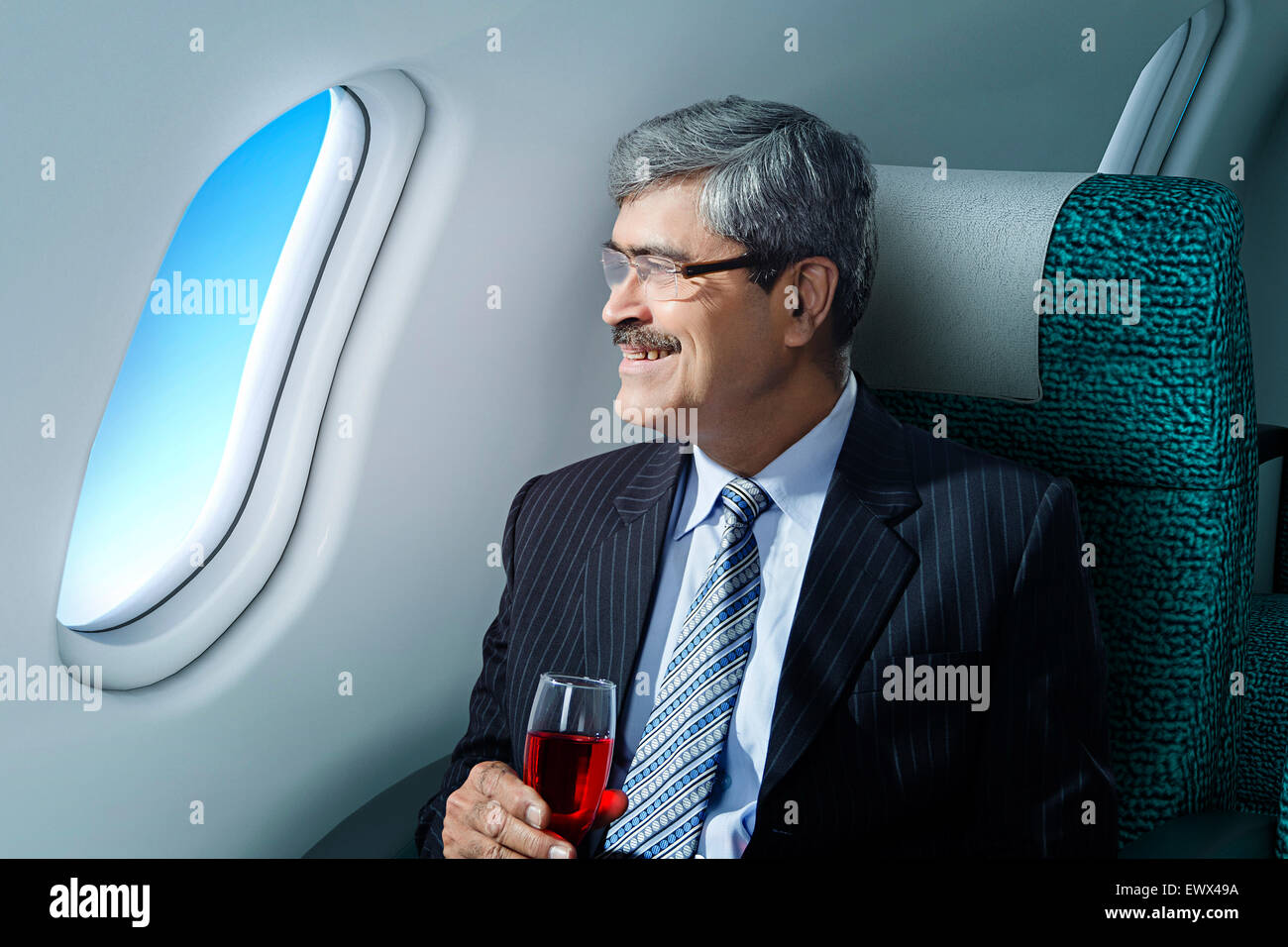 1 Business Man Sitting Aeroplane happy Journey - Stock Image