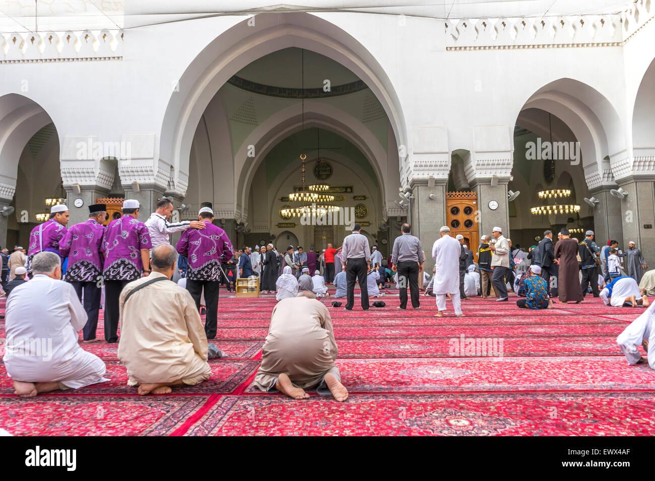 MEDINA, SAUDI ARABIA - MARCH 07, 2015 : Muslims pray inside Masjid Quba in Medina, Saudi Arabia. - Stock Image