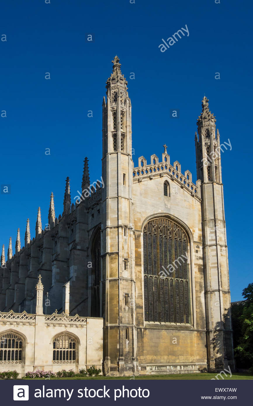 Kings College Chapel catches the early morning sunshine with the backdrop of a vivid blue sky - Stock Image