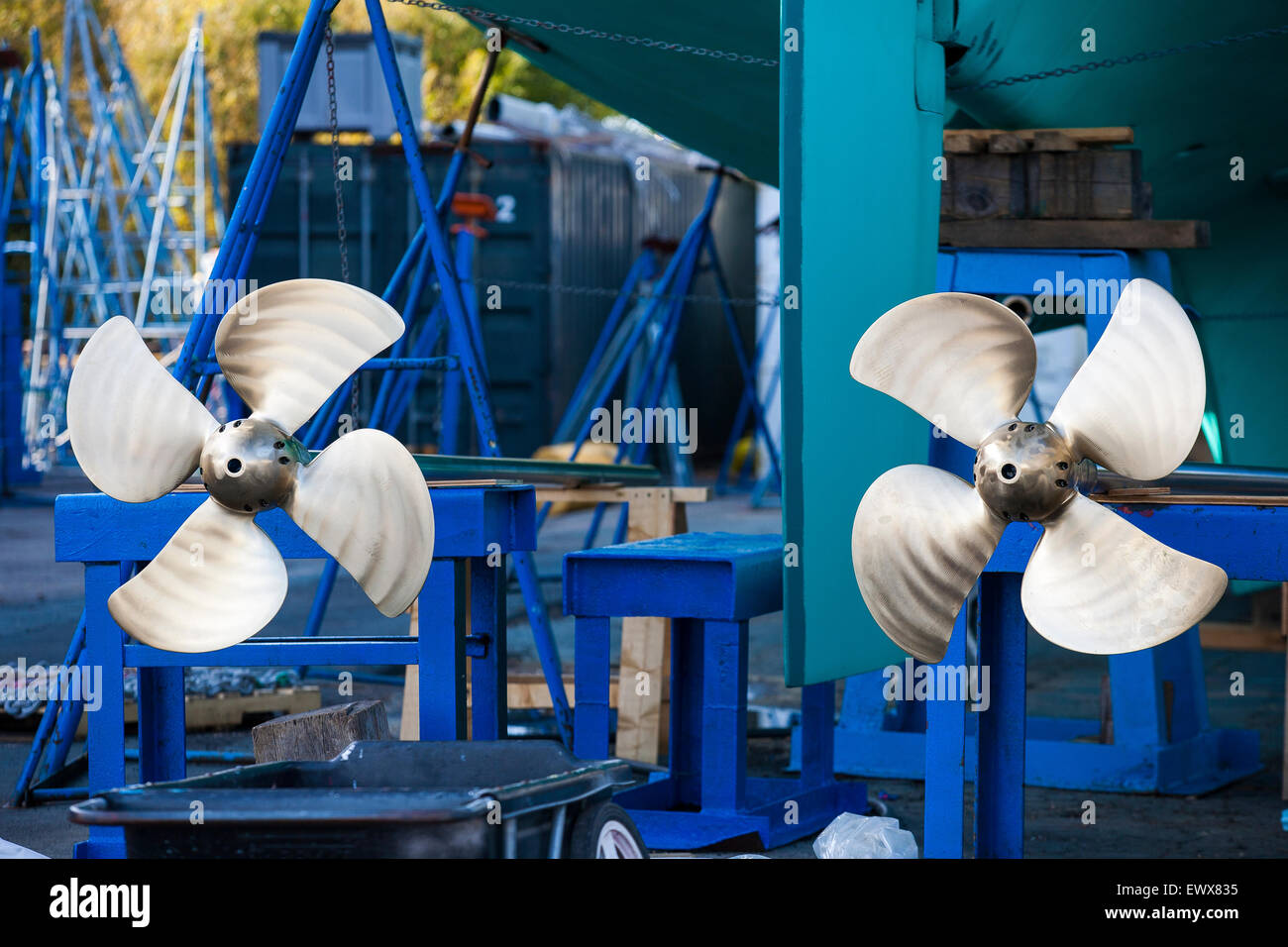 Twin shiny propellers freshly polished on a large sailing yacht out of the water at Newport Shipyard, R.I. - Stock Image