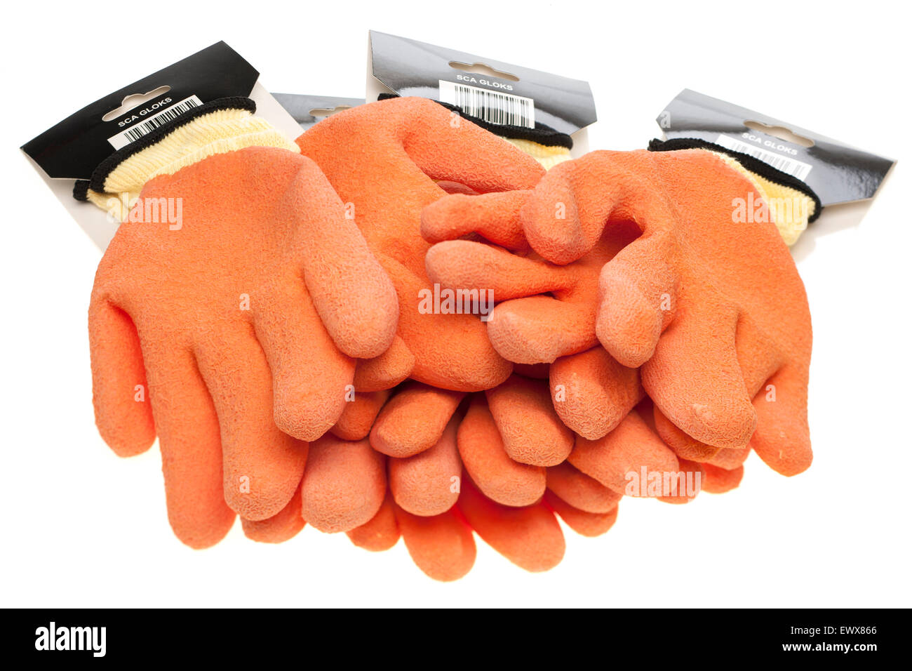 Four pairs of orange and yellow  non slip latex coated and knitted seamless safety wear work gloves - Stock Image