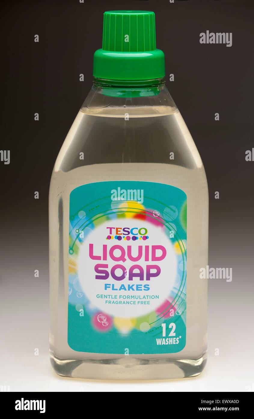 Tesco bottle of 12 wash liquid soap flakes for delicates - Stock Image