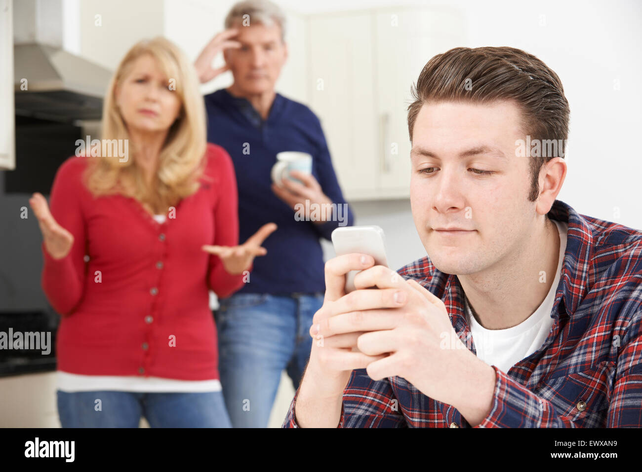 Mature Parents Frustrated With Adult Son Living At Home - Stock Image