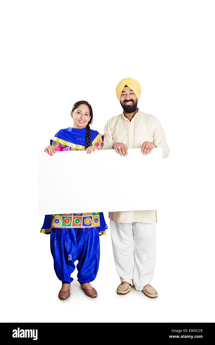 2 indian Punjabi Married Couple showing Message Board Stock Photo