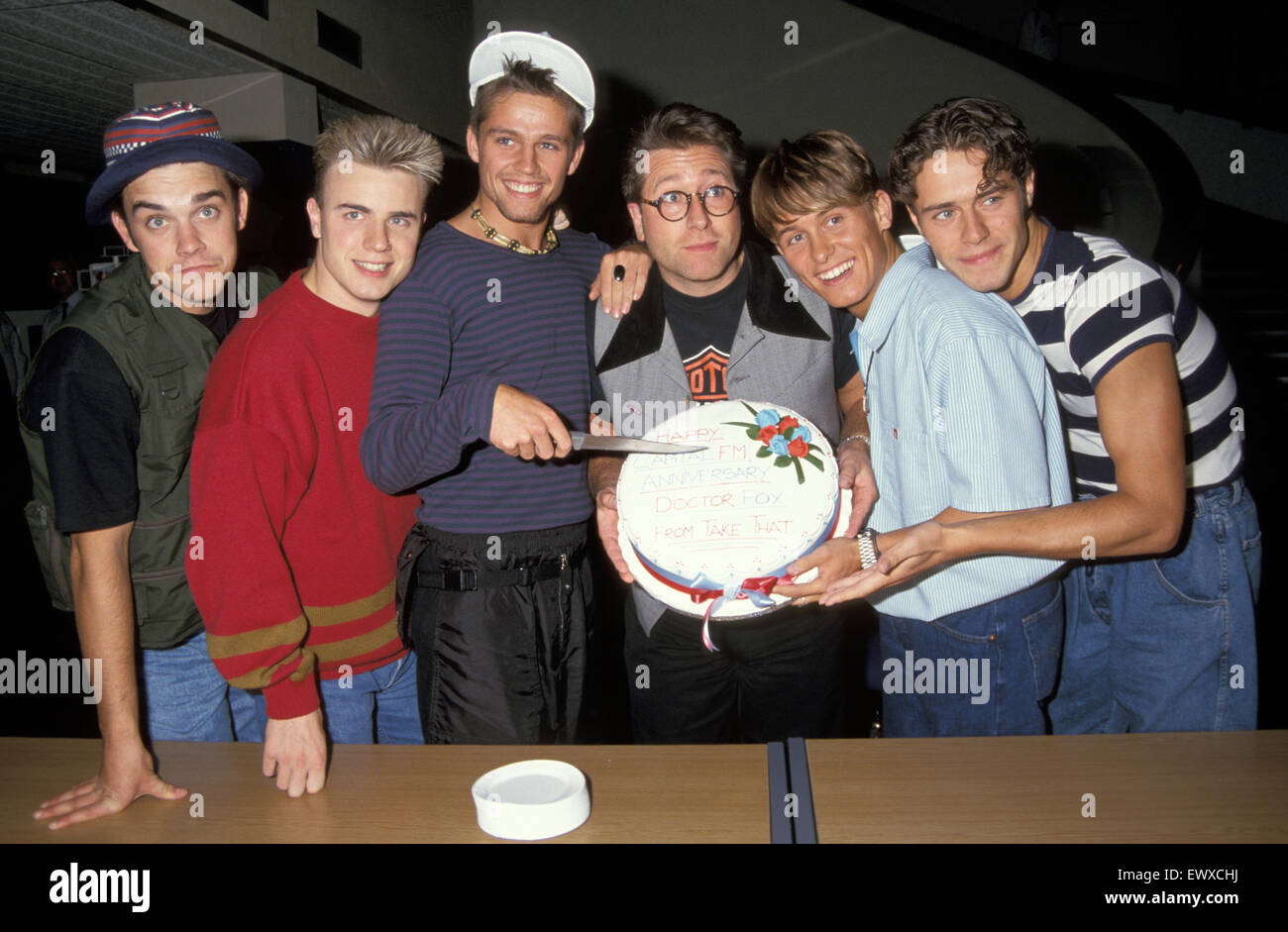 TAKE THAT UK pop group with DJ Neil Fox about 1993 - Stock Image