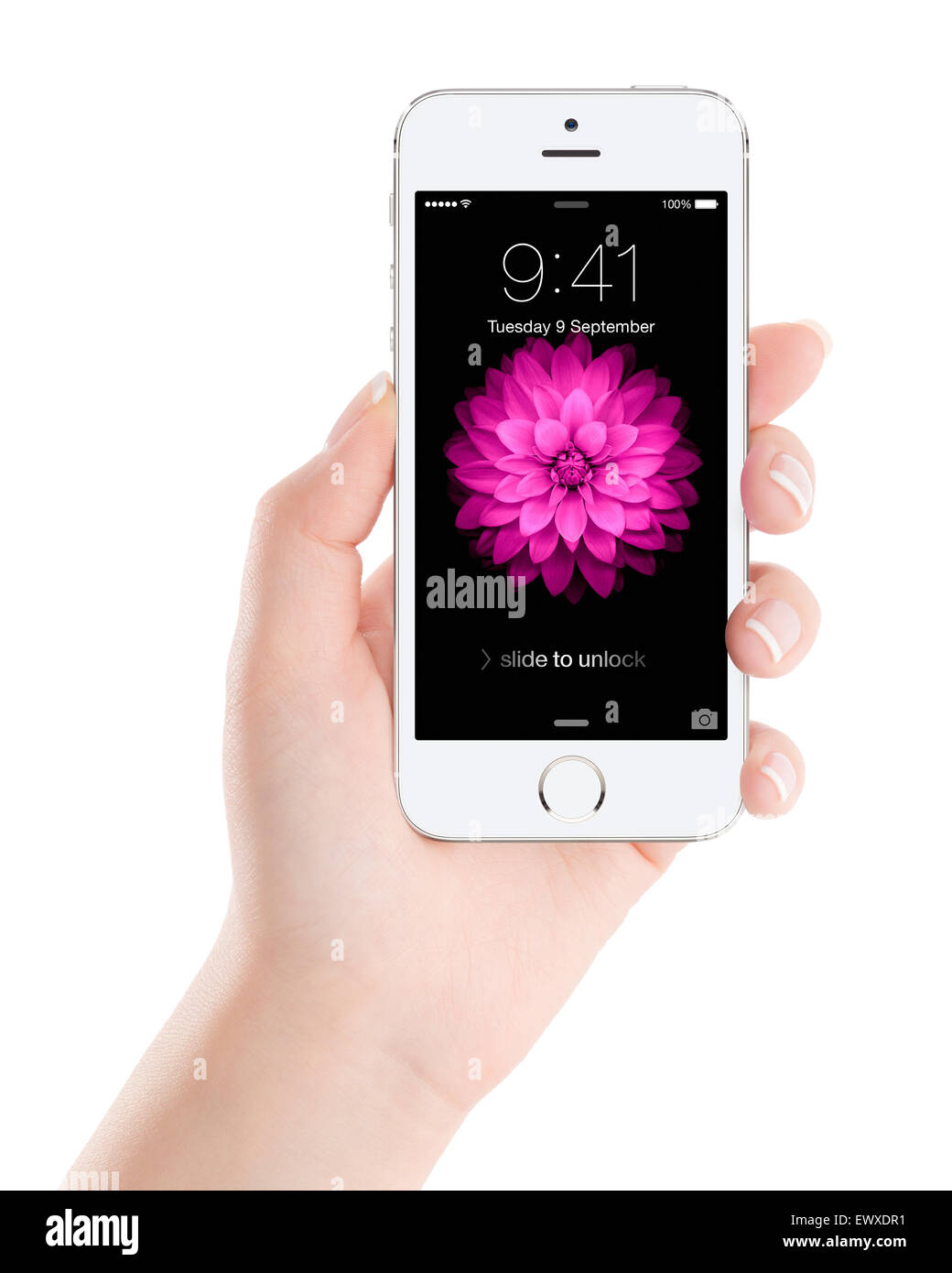 Varna, Bulgaria - December 07, 2013: Female hand holding Apple Silver iPhone 5S with lock screen on the display, - Stock Image