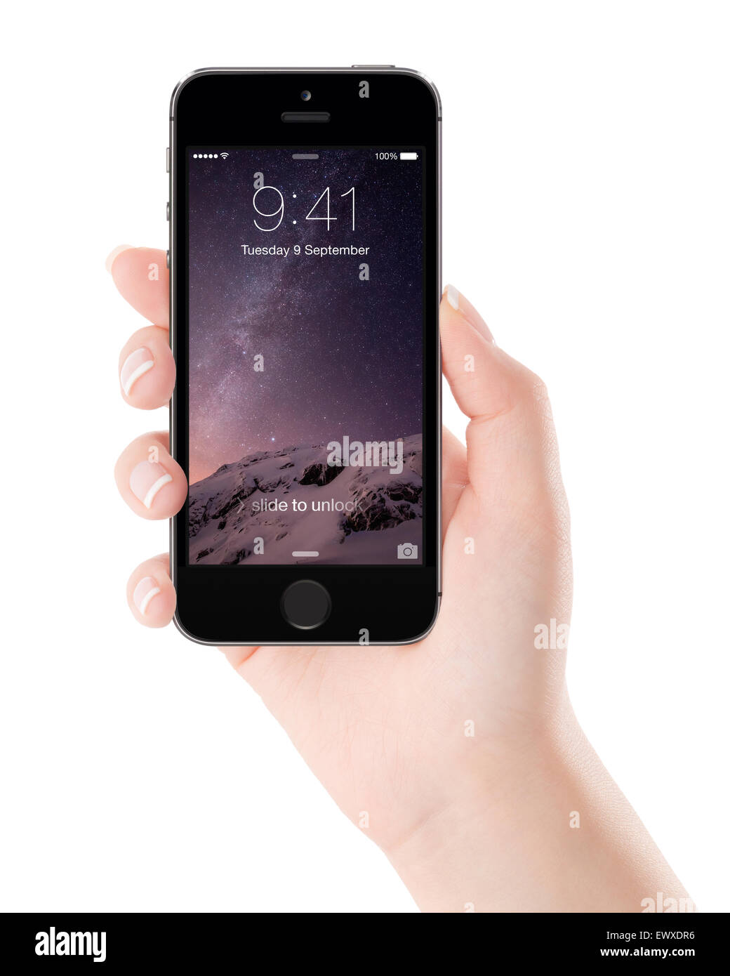 Varna, Bulgaria - December 07, 2013: Female hand holding Apple Space Gray iPhone 5S with lock screen on the display - Stock Image