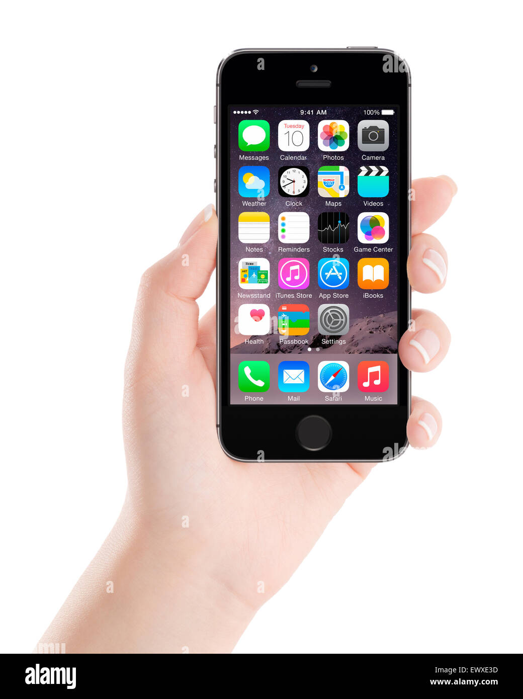 Varna, Bulgaria - December 07, 2013: Female hand holding Apple Space Gray iPhone 5S displaying iOS 8 mobile operating - Stock Image