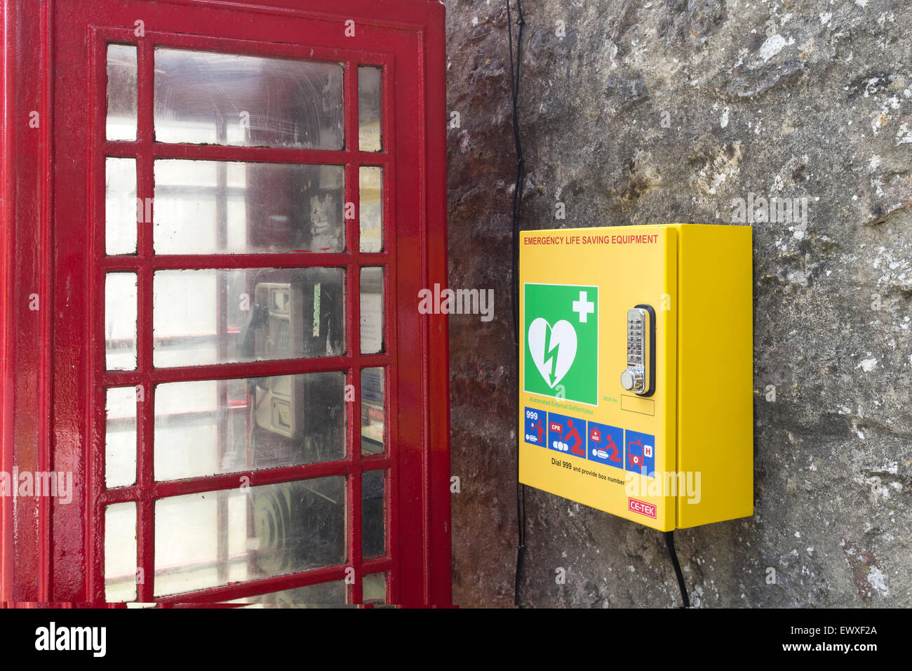 Emergency Public Access External Defibrillator Located Next to a Phone Box in the Village of Starbottom, Wharfedale, - Stock Image