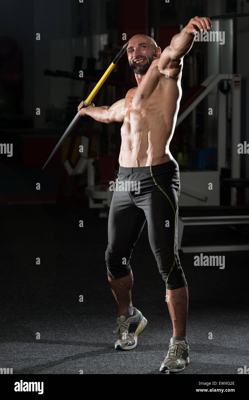 Mature Man Athlete Practicing To Throw A Javelin - Stock Image