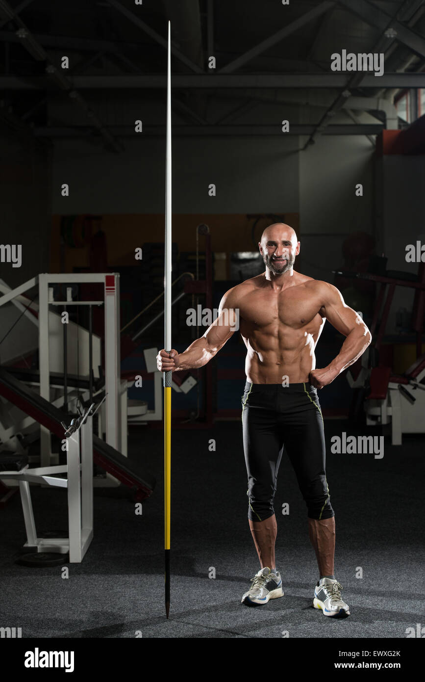 Portrait Of A Physically Fit Mature Male With Javelin - Stock Image