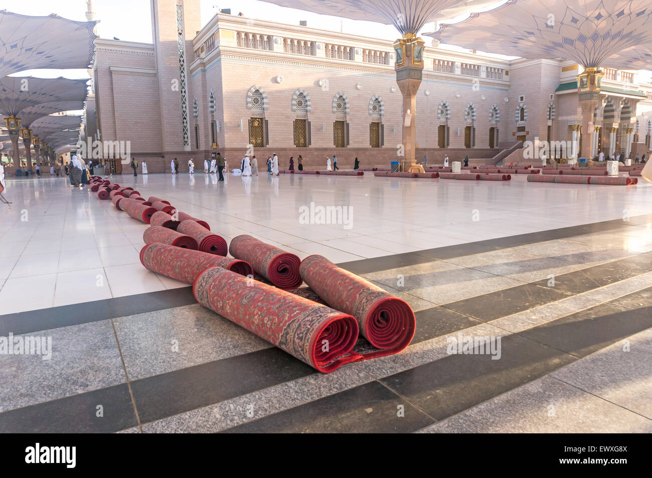 MEDINA - MARCH 06 : Mat rolls for cleaning at Nabawi Mosque compound on March 06, 2015 in Medina, Kingdom of Saudi Stock Photo
