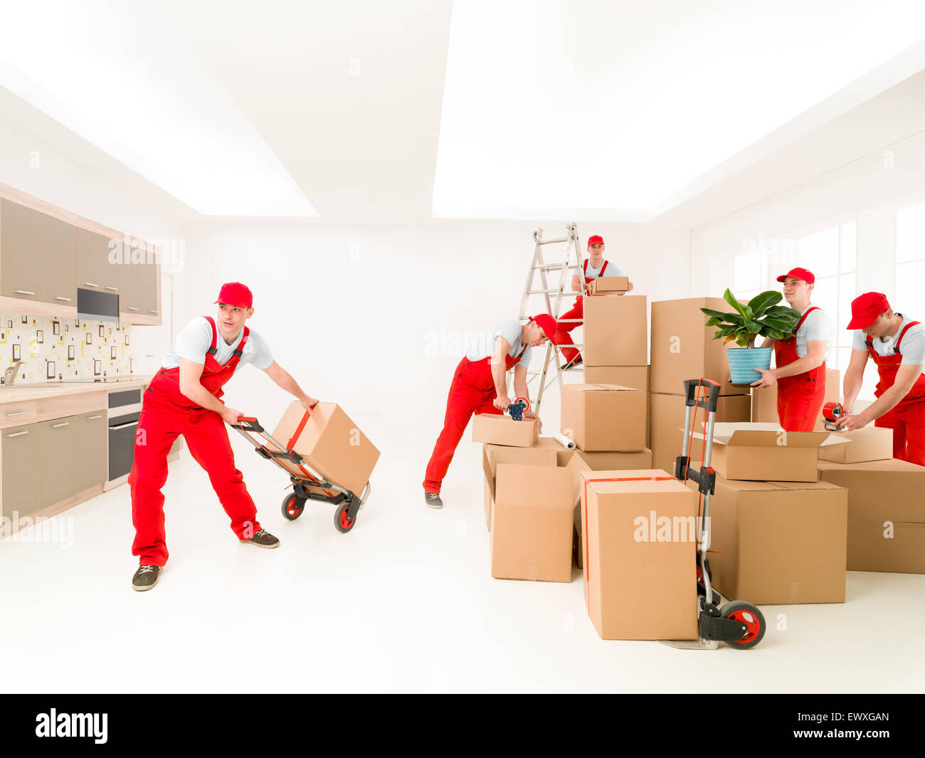 delivery man at work, delivering cargo to new house. digital composite image - Stock Image