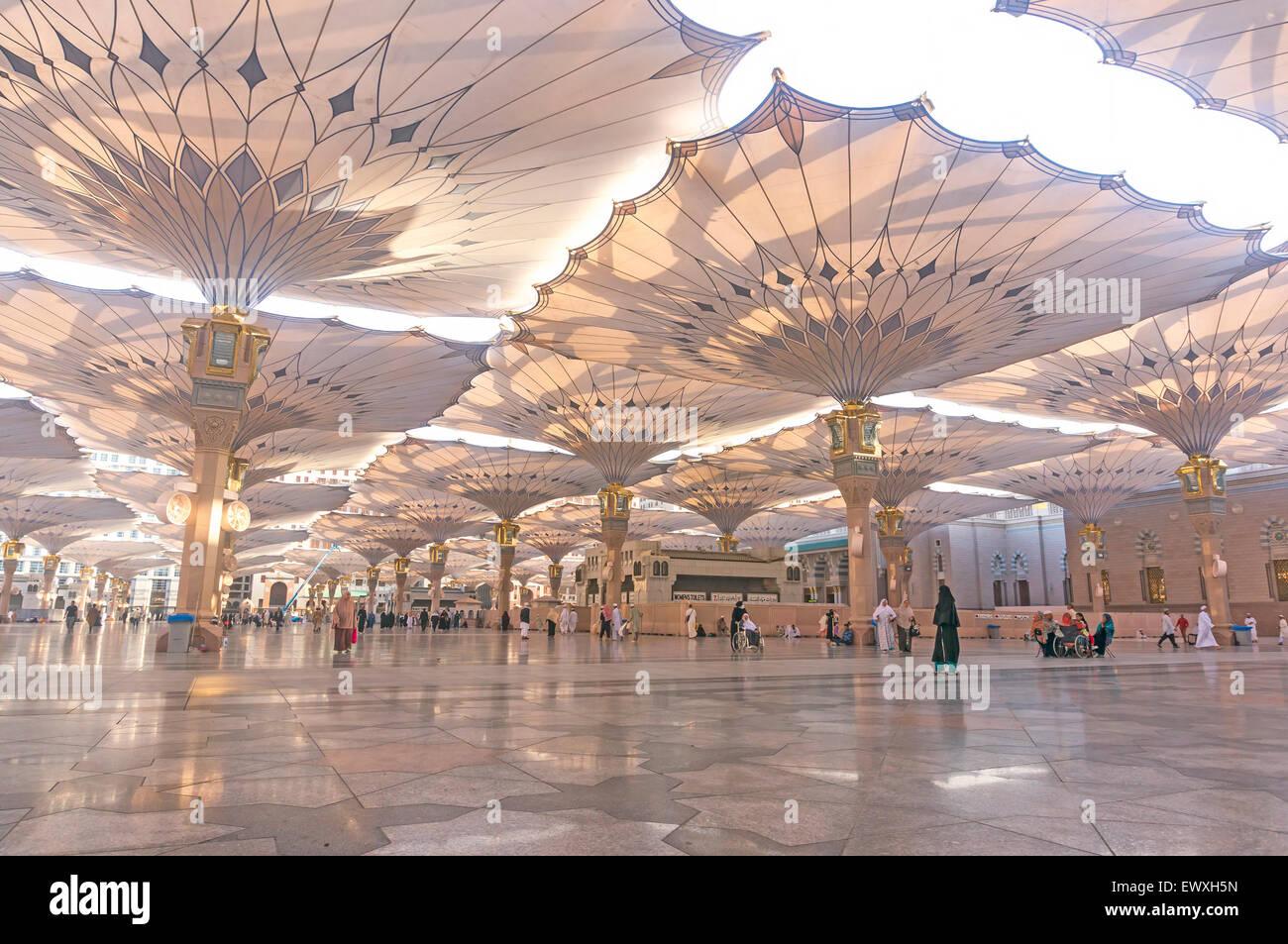 medina saudi arabia march 06 2015 pilgrims walk underneath