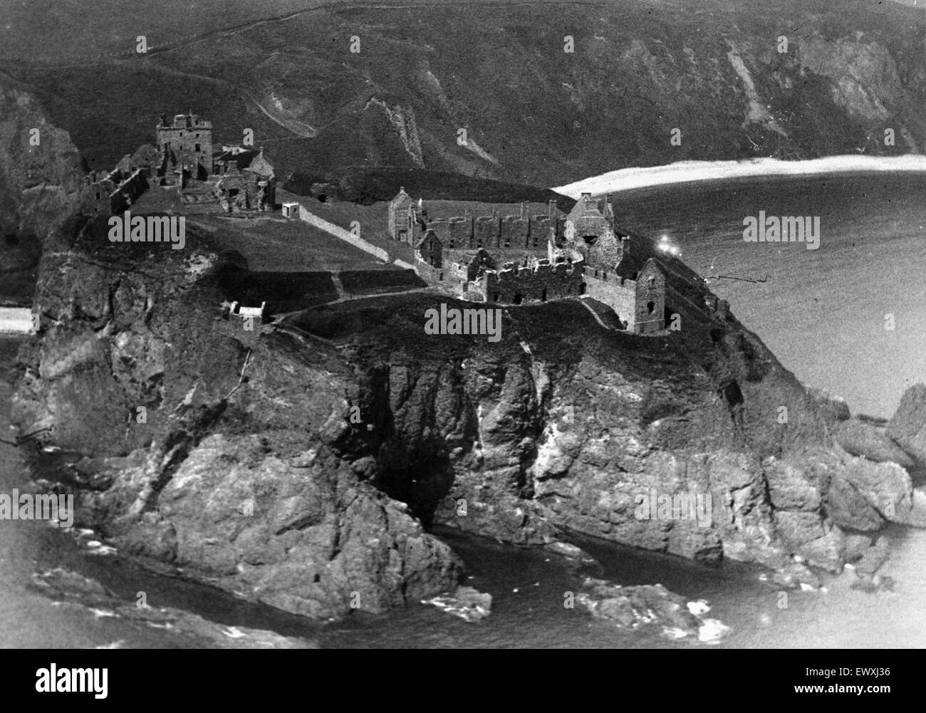 General view of the ruined medieval fortress of Dunnottar Castle near Stonehaven, Aberdeenshire. Circa 1935. - Stock Image