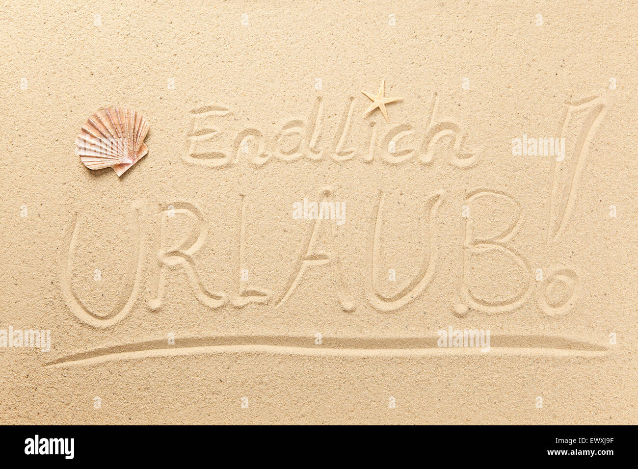 Finally Holiday written in sand Stock Photo