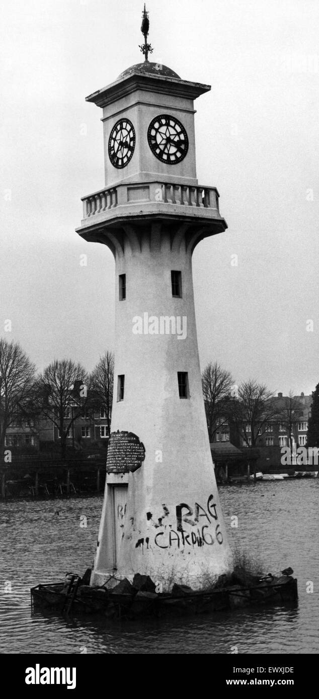 The lighthouse memorial in the lake at Roath Park, Cardiff, Wales, with the words 'Cardiff RAG '66' - Stock Image
