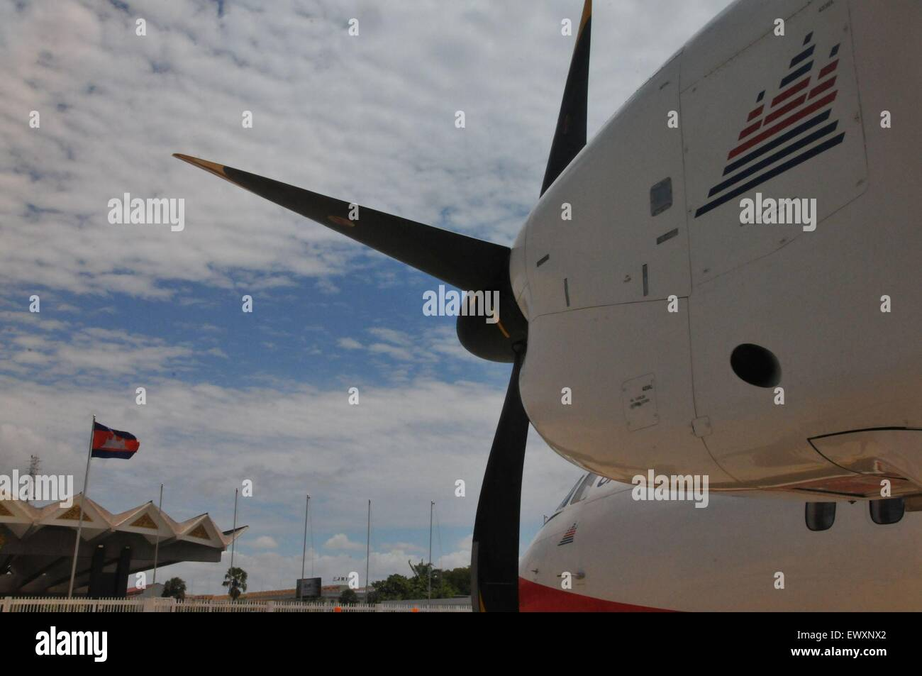Phnom Penh, Cambodia. 1st July, 2015. An MA60 turboprop-powered aircraft of Cambodia Bayon Airlines is seen before - Stock Image
