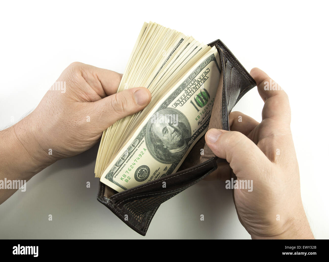 opening the wallet full of money stock photo 84802995 alamy