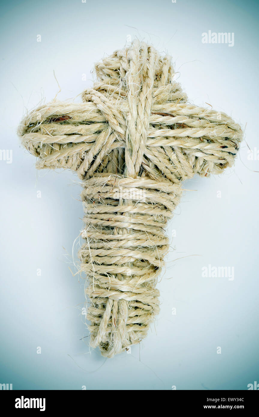 closeup of a cross-shaped coil of rope - Stock Image
