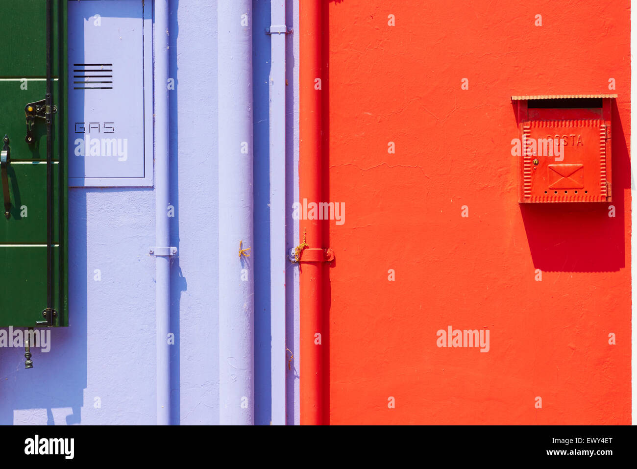 Brightly painted wall with postbox gas services and pipes Burano Venetian Lagoon Veneto Italy Europe Stock Photo