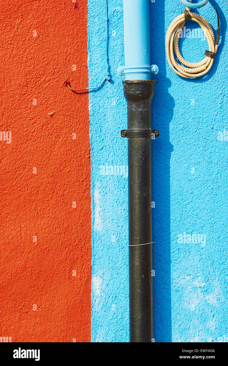 Pipes and wires on blue and rust coloured wall Burano Venetian Lagoon Veneto Italy Europe Stock Photo