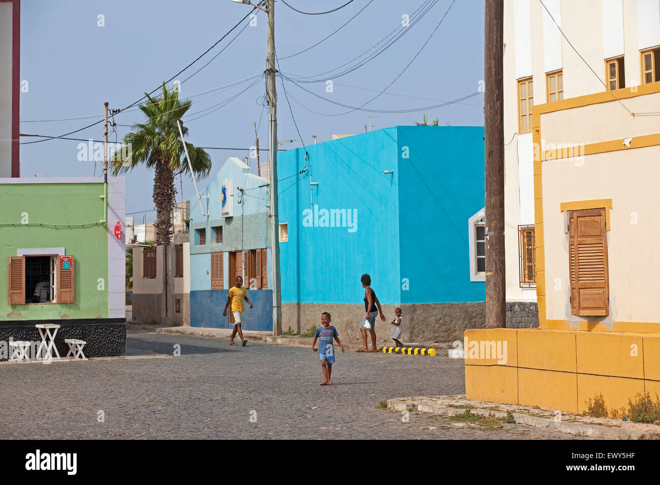 Street with colourful houses at the fishing village Palmeira on the island of Sal, Cape Verde / Cabo Verde, Western - Stock Image
