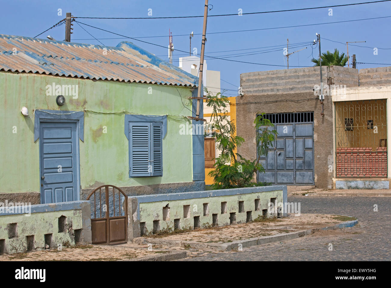 Colourful Portuguese colonial house in old part of the fishing village Palmeira on the island of Sal, Cape Verde - Stock Image
