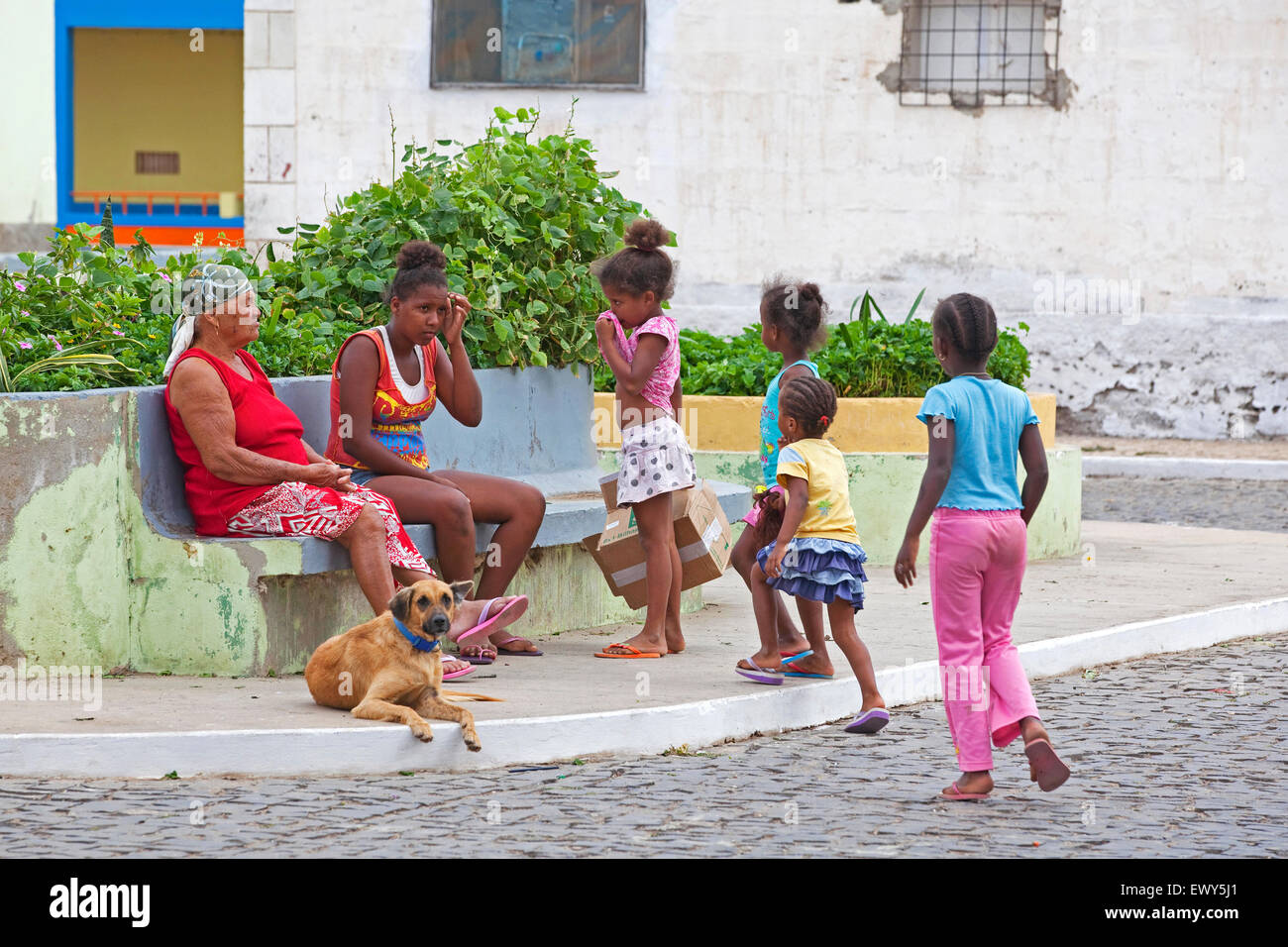 Old Creole woman and children in the fishing village Palmeira on the island of Sal, Cape Verde / Cabo Verde, Western - Stock Image